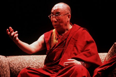 Photo for AUCKLAND - APRIL 10 2003: His Holiness the 14th Dalai Lama of Tibet is giving a speech in Auckland New Zealand in April 10 2003. He has lived in exile in India since the Chinese Army crushed an uprising in his homeland in 1959. - Royalty Free Image