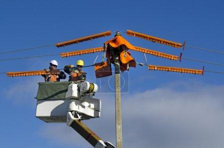 MANGONUI,NZ - JUNE 11:Electrical workers repairs p...
