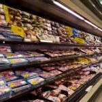 Постер, плакат: Meat on shelves in supermarket