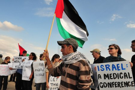 Photo for EREZ CROSSING - OCT 26:Foreign doctors protest at the Erez crossing on 26.10.2008.Israel prevented them crossing into Gaza to attend a medical conference hosted by the World Health Organization. - Royalty Free Image