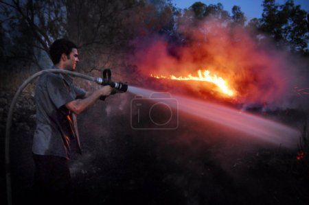 Firefighter fights large wildfire
