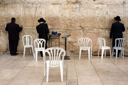 Jewish pray at the Western Wall in Jerusalem Israel