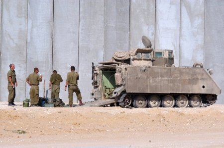 Israeli soldiers and armored vehicle
