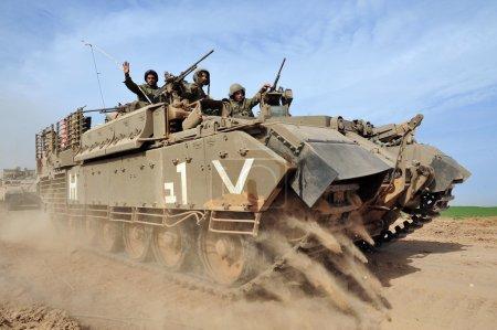 Israeli soldiers on armed vehicle