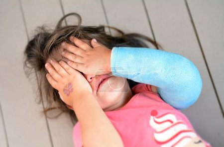 Abused little girl with a broken arm