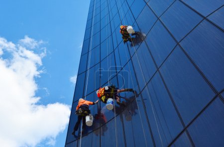 MELBOURNE - APR 14, 2014:Window cleaners works on ...
