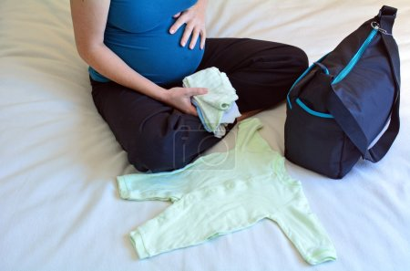 Pregnant woman packing a Hospital Bag