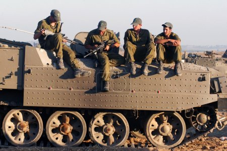 Israeli soldiers on armed vehicle