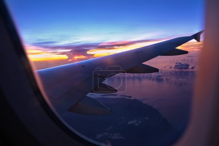A view from airplane windows showing sunset sky an...