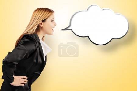 Photo for Smiling elegant woman speaking in yellow speech balloon. Yellow gradient background - Royalty Free Image