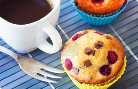 Delicious breakfast with muffins and hot coffee