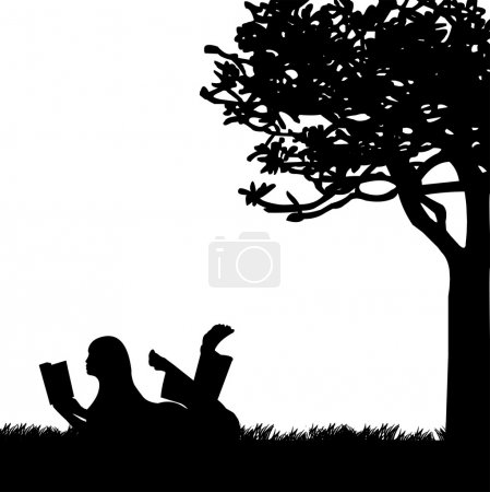 Silhouette of girl reading a book under the tree in spring