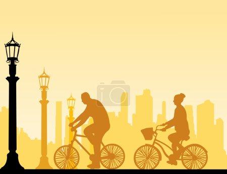 Couple bike ride on the street silhouette