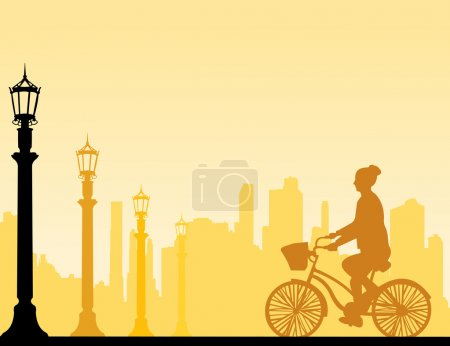 Girl bike ride on the street silhouette