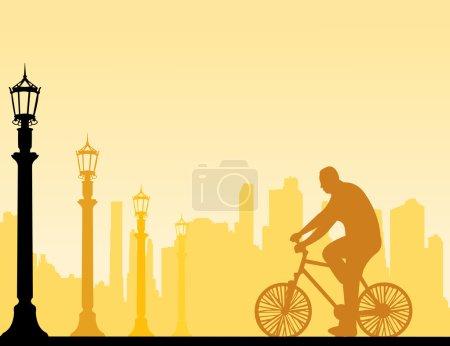 Man bike ride on the street silhouette