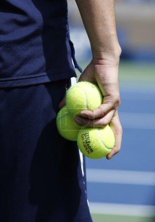 Ball boy holding Wilson tennis balls at the Billie Jean King National Tennis Center