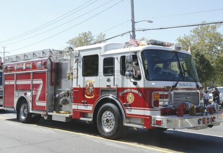 Huntington Manor Fire Department fire truck at the parade in Huntington , New York