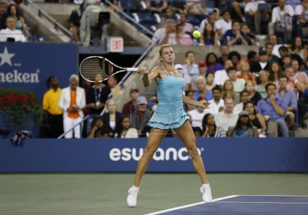 Professional tennis player Camila Giorgi during third round match at US Open 2013 against Caroline Wozniacki at Billie Jean King National Tennis Center