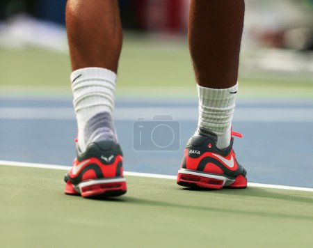 Twelve times Grand Slam champion Rafael Nadal wears custom Nike tennis shoes during practice for US Open 2013 at Billie Jean King National Tennis Center