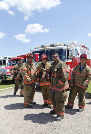 Firefighters from Freeport Truck 1 Technical Rescue company standing in the front of fire truck