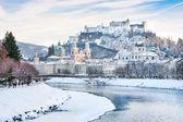 Salzburg skyline with Festung Hohensalzburg and river Salzach in winter, Salzburger Land, Austria