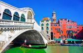 Rialto bridge with traditional Gondola under the bridge in Venice, Italy