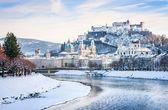 Beautiful view of Salzburg skyline with Festung Hohensalzburg and river Salzach in winter, Salzburger Land, Austria