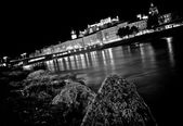 Artistic view of the city of Salzburg with river Salzach at night in black and white, Salzburger Land, Austria