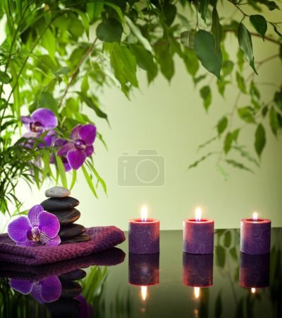 Photo for Spa still life with zen stones aromatic candles and orchids - Royalty Free Image