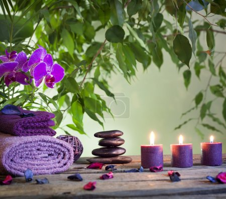 Spa still life with zen stones aromatic candles and orchids