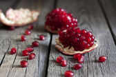 Pomegranate on wooden boards abstract closeup