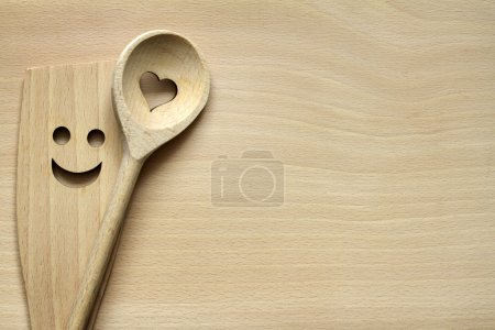 Photo for Wooden kitchenware on cutting board abstract food background - Royalty Free Image