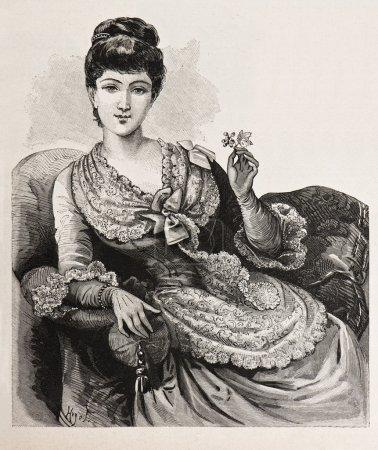 Jeune femme élégante en belle robe de corsage