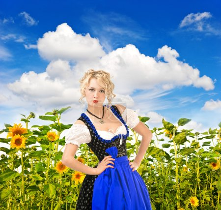 Bavarian girl in typical oktoberfest dress outdoors