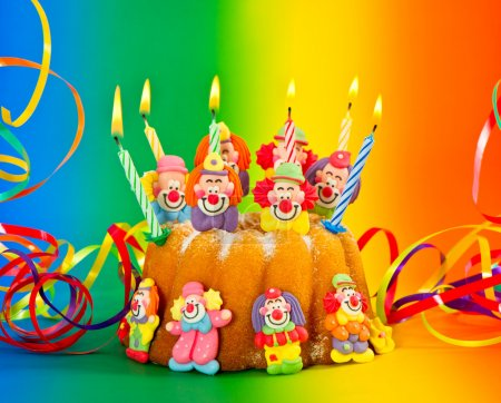 Photo for Birthday cake with candles and streamer on colorful background - Royalty Free Image