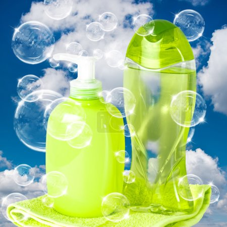 Soap bubbles on cloudy sky background