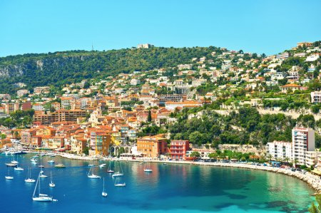Photo for View of luxury resort and bay on sunny day. Villefranche-sur-Mer, Cote d'Azur, french reviera, near Nice and Monaco - Royalty Free Image