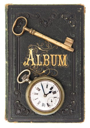 Vintage poetry album with ild key and clock