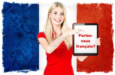 Photo for Parlez-vous français? young woman holding tablet pc on the background with french national flag. french language learning concept - Royalty Free Image
