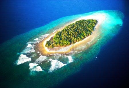 top view of tropical island in turquoise blue water