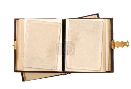 Foto de El álbum antiguo Open con tarjetas fotográficas vacío aislado sobre fondo blanco. cuadro nostálgico Vintage - Imagen libre de derechos