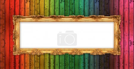 Long old golden frame over colorful wooden wall