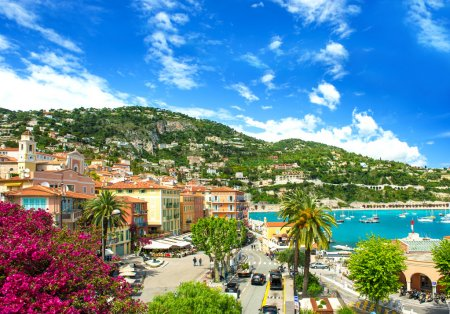 Photo for French reviera, view of luxury resort and bay of Villefranche-sur-Mer near Nice and Monaco. mediterranean sea landscape with azalea flowers - Royalty Free Image