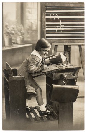 Vintage sepia portrait of a first grader school girl in the clas