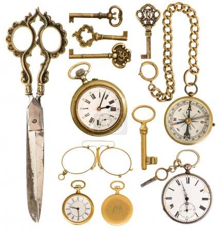 golden vintage accessories. antique keys, clock, scissors, compa