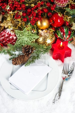 Photo for Festive christmas table place setting decoration in red and gold - Royalty Free Image