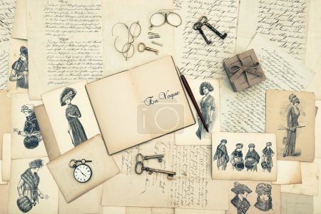 Antique accessories, old letters and fashion drawings