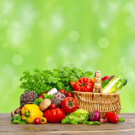 Vegetables and herbs over green background