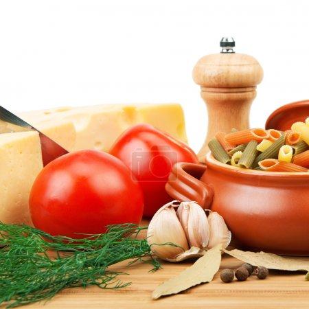 Vegetables, pasta, spices and kitchen utensils