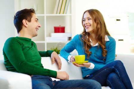 Photo for Portrait of joyful friends looking at one another while chatting - Royalty Free Image